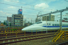 KYOTO, JAPAN - JULY 05, 2017: JR700 shinkansen bullet train departing Kyoto station shown on August 12, 2015 in Kyoto Royalty Free Stock Image