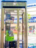 KYOTO, JAPAN - JULY 05, 2017: Public phone in Osaka, Japan. Blurry phone through the glass Royalty Free Stock Image