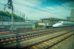 KYOTO, JAPAN - JULY 05, 2017: Rails with a train JR700 shinkansen bullet train arriving to Kyoto station in Kyoto, Japan Royalty Free Stock Photo