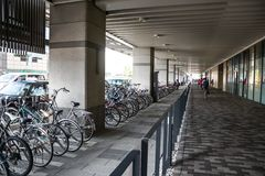 Kyoto, Japan - 24 July 2016. Street in Kyoto on a summer day in July, people walking along the sidewalk, visible bicycle parking. royalty free stock images
