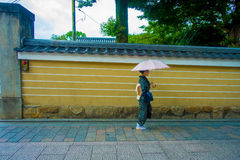 KYOTO, JAPAN - JULY 05, 2017: Unidentified woman holding an umbrella and walking in the city to visit the beautiful view. Of Yasaka Pagoda Gion Higashiyama Stock Photography
