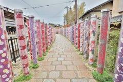 Kyoto, Japan, Kimono forest poles in kyoyuzen style. Randen Arashiyama Station in Arashiyama, Kyoto Stock Photos