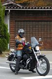 Man on motorcycle ready to depart stock images