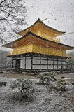 KYOTO, JAPAN - MARCH 10 2014: Old Japanese golden castle, Kinkakuji Temple (The Golden Pavilion) in snow during winter. Royalty Free Stock Images