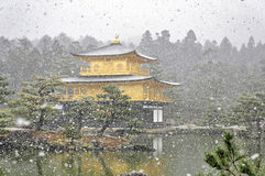 KYOTO, JAPAN - MARCH 10 2014 : Old Japanese golden castle, Kinkakuji Temple  in snow during winter. Royalty Free Stock Photos