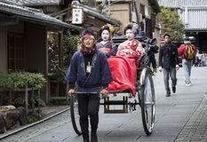 Geishas in a Rickshaw Stock Photos