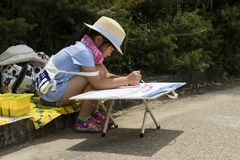 Kyoto, Japan - May 21, 2017: Child is painting in the Kyoto botanical garden stock photos
