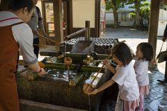 Kyoto, Japan - May 18, 2017: Children cleaning their hands at a stock photo