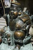 Kyoto, Japan - May 18, 2017: Ebisu statue, the Japanese god of f. Kyoto, Japan - May 18, 2017:  Ebisu statue, the Japanese god of fishermen and luck, he is one Stock Photos