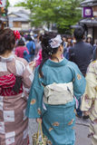 KYOTO, JAPAN - MAY 01, 2014: Japanese women wear a traditional d Royalty Free Stock Photos