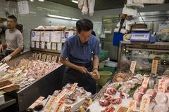 Kyoto, Japan -  May 22, 2017:  Opening a raw oyster as a snack. At the Nishiki market in kyoto, called Kyoto`s Kitchen Stock Photo