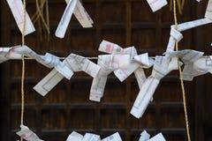 Kyoto, Japan - May 18, 2017:  Paper prayers and wishes at the Ya Royalty Free Stock Photos