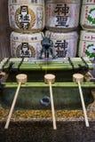 Kyoto, Japan - May 16, 2017: Row of ladles at a purificaton basin royalty free stock images