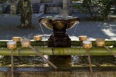 Kyoto, Japan - May 18, 2017: Row of ladles at a purificaton basin stock image
