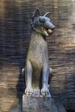 Kyoto, Japan - May 19, 2017:  Kitsune, animal guardian besides a. Kyoto, Japan - May 19, 2017: Traditional stone fox statue, Kitsune, animal guardian besides an Royalty Free Stock Photography