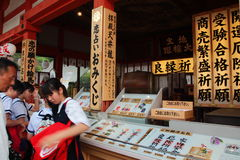 Kyoto, Japan - May 28, 2015: Unidentified Visitors purchase Japanese luck amulet in Kiyomizu-Dera Temple Royalty Free Stock Photography