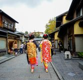 Women wear Japanese kimono on street. Kyoto, Japan - Nov 20, 2016. Japanese women wearing traditional dress Kimono on the historic street in downtown of Kyoto royalty free stock photos