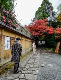 Women wear Japanese kimono on street. Kyoto, Japan - Nov 20, 2016. Japanese women wearing traditional dress Kimono on the historic street in downtown of Kyoto royalty free stock image