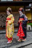 Women wear Japanese kimono on street. Kyoto, Japan - Nov 20, 2016. Japanese women wearing traditional dress Kimono on the historic street in downtown of Kyoto stock photo