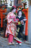 KYOTO, JAPAN - NOVEMBER 8, 2011: Maiko and Geiko. In traditional clothes attending the annual Kanikakni festival in Gion, Kyoto Royalty Free Stock Photos