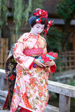 KYOTO, JAPAN - NOVEMBER 8, 2011: Young Maiko. In traditional clothes attending the annual Kanikakni festival in Gion, Kyoto Royalty Free Stock Photo