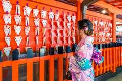 Asian women wearing japanese traditional kimono visiting the beautiful in Fushimi Inari Shrine in Kyoto, Japan stock image