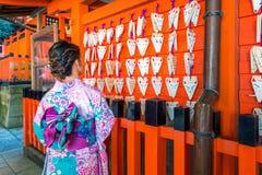 Asian women wearing japanese traditional kimono visiting the beautiful in Fushimi Inari Shrine in Kyoto, Japan royalty free stock photos
