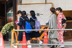 KYOTO, JAPAN - NOVEMBER 7, 2017: Couple in a kimono on a city st. Reet. Copy space for text stock photo