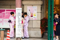 KYOTO, JAPAN - NOVEMBER 7, 2017: Girls in a kimono on a city street. Copy space for text. KYOTO, JAPAN - NOVEMBER 7, 2017: Girls in a kimono on a city street royalty free stock photography