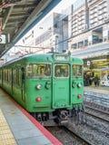 Green old train at Arashiyama station, Japan. KYOTO, JAPAN - NOVEMBER 24 : Green car classic train from Kyoto station stops at Arashiyama train station in Kyoto Royalty Free Stock Photos