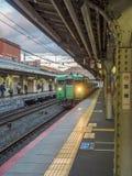 Green old train at Arashiyama station, Japan. KYOTO, JAPAN - NOVEMBER 24 : Green car classic train from Kyoto station stops at Arashiyama train station in Kyoto Royalty Free Stock Photography