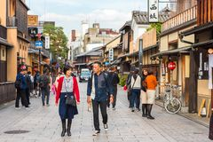 KYOTO, JAPAN - NOVEMBER 7, 2017: Groups of people on a city street. Copy space for text. KYOTO, JAPAN - NOVEMBER 7, 2017: Groups of people on a city street royalty free stock photo