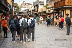 KYOTO, JAPAN - NOVEMBER 7, 2017: Groups of people on a city street. Copy space for text. KYOTO, JAPAN - NOVEMBER 7, 2017: Groups of people on a city street stock images