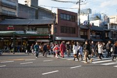 Kyoto, Japan - November 27, 2017: Pedestrians cross the street u stock images