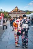People dressed in Japanese traditional costume visiting Yasaka Shrine in Kyoto. Kyoto, Japan -November 2, 2018: People dressed in traditional kimonos in front of stock photo