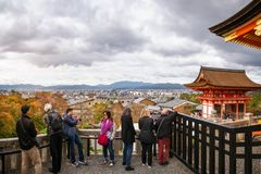 Kyoto View from Kiyomizu-dera Temple Terrace, Kyoto, Japan. Kyoto, Japan -November 2, 2018: People enjoying the view of Kyoto in autumn from one of the terraces royalty free stock photography