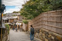 Traditional Vintage Street in Gion, Kyoto, Japan. Kyoto, Japan -November 2, 2018: People visiting the old traditional streets of Gion District with boutique royalty free stock photo