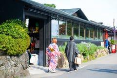 Kyoto, Japan - November 17, 2017: People walking on the street i. N Arashiyama town, Kyoto, Japan Royalty Free Stock Images