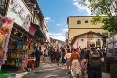 Walking on a beautiful morning to Kiyomizu-dera Buddhist Temple in Kyoto, Japan. Kyoto, Japan -November 2, 2018: People are walking on a street on a beautiful royalty free stock images