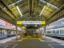 Platform scene at Arashiyama train station, Japan. KYOTO, JAPAN - NOVEMBER 24 : Platform scene of Arashiyama train station with sign and exit in Arashiyama Stock Image