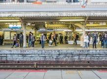 Platform scene at Arashiyama train station, Japan. KYOTO, JAPAN - NOVEMBER 24 : Platform scene of Arashiyama train station with sign and exit in Arashiyama Royalty Free Stock Photos