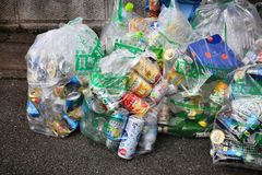 Sorted household waste. KYOTO, JAPAN - NOVEMBER 25, 2016: Sorted garbage bags in Kyoto, Japan. 19 percent of municipal waste was recycled in Japan in 2013 (OECD Royalty Free Stock Images