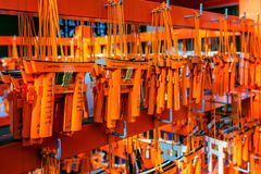 Torii gates model was hanging on rack after tourist used them for make a wish at Fushimi Inari shrine, Kyoto. Royalty Free Stock Images