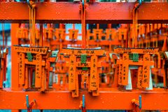 Torii gates model was hanging on rack after tourist used them for make a wish at Fushimi Inari shrine, Kyoto. Royalty Free Stock Photo