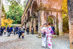 KYOTO, JAPAN - November 29, 2015 : Tourists dress Kimono visit N. Anzenji temple  on November 29, 2015 Kyoto, Japan. Nanzenji temple is one of the most popular Stock Image