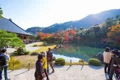 Kyoto, Japan - November 17, 2017 :Tourists enjoy travel to Sogen. Chi pond garden in autumn season at Tenryuji temple, Kyoto, Japan Stock Photo