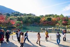 Kyoto, Japan - November 17, 2017 :Tourists enjoy travel to Sogen. Chi pond garden in autumn season at Tenryuji temple, Kyoto, Japan Royalty Free Stock Images