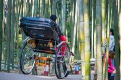 Kyoto, Japan - November 16, 2017 :Tourists are enjoy traveling b. Y rickshaw service at bamboo forest of Arashiyama, Kyoto, Japan Royalty Free Stock Photography