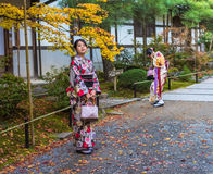 KYOTO, JAPAN - November, 18, 2014: Two japanese girls in kimono stock photos