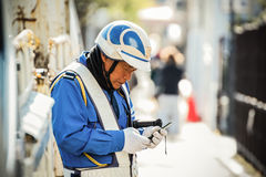 Kyoto, Japan - November 20 2013: Unidentified senior security gu Royalty Free Stock Photos